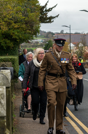 sombre: WREXHAM, UK - NOVEMBER 13, 2016: The Remembrance Parade along Coedpoeth High Street. An annual parade from St Tydfil church to the War memorial on Remembrance Sunday, also known as Poppy Day. Editorial