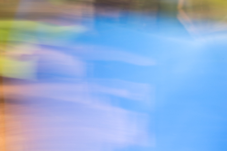 spectral color: Blurred abstract background. Colourful pastel water reflections concept. Stock Photo