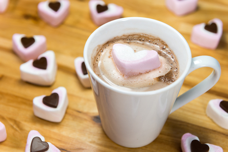 Marshmallow hearts and yummy hot chocolate drink on a wooden table. Love of sugary food or Valentines day concept Stock fotó