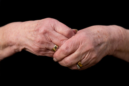 Widows Hands Clasped In Grief Wearing Her Late Husbands Wedding