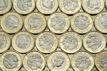 bimetallic: Close up of British money, new pound coins background laid flat. Overhead point of view. The bimetallic coin was introduced in March 2017. These coins are dated 2016. Stock Photo