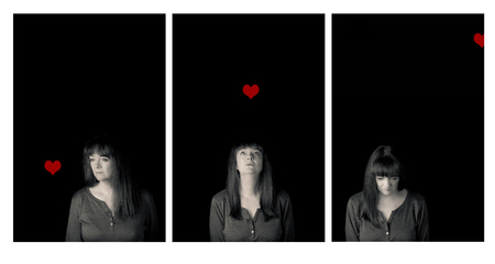 Triptych portrait of a mature woman and a red heart. Conceptual story of love and loss. Low key. Stock Photo
