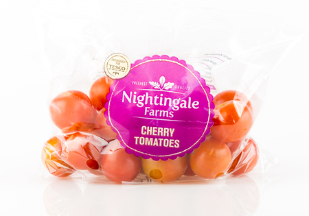 WREXHAM, UK - MAY 24, 2017: Bag of Nightingale Farms cherry tomatoes exclusively for Tesco on a white background.