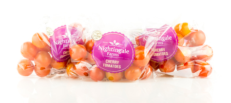 WREXHAM, UK - MAY 24, 2017: Three bags of Nightingale Farms cherry tomatoes exclusively for Tesco on a white background. Sajtókép