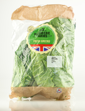 WREXHAM, UK - MAY 24, 2017: Bag of Redmere Farms Fresh Greens exclusively for Tesco supermarket. On a white background.