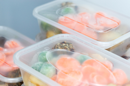 Meal prep. Close up of home made roast chicken dinners in containers ready to be frozen for later use.