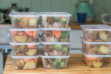 Meal prep. Stack of home cooked roast chicken dinners in containers ready to be frozen for later use as quick and easy ready meals. Stock Photo