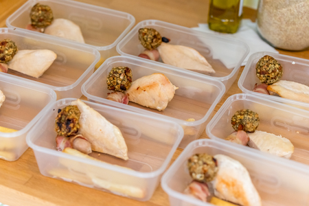 Meal prep. Home made meals, part way through filling containers to be frozen for later use. Roast chicken, stuffing balls, pigs in blankets and parsnips.