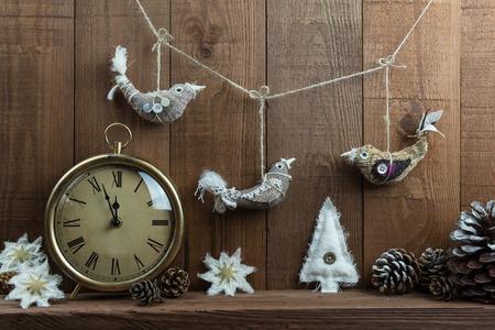 Rustic Christmas Eve Scene With Clock And Handmade Fabric Decorations Birds Stars