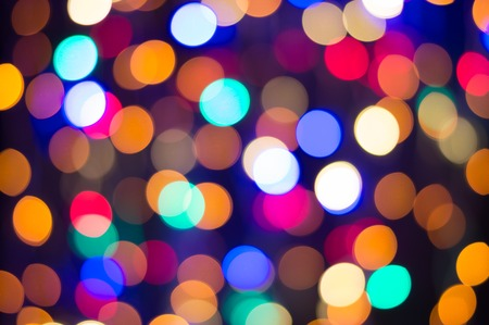 Christmas fairy lights, multi-colored defocussed bokeh background. Bright party blurred lights.