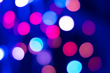 Blue and magenta Festive Christmas background. Abstract overlay or background with bokeh lights.