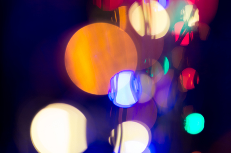 Colorful circles of light, disco party background. Nightlife celebration bokeh.