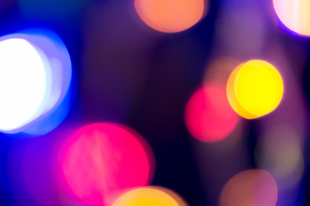 Colorful circles of light, disco party background. Nightlife celebration bokeh. Close up. Stock Photo