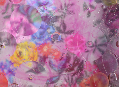 Oil and water abstract background. Colorful blurred flowers with circular shapes and optical distortion.