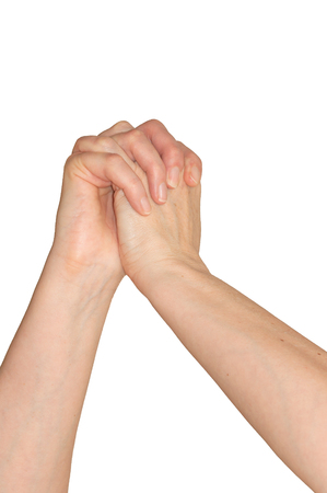Caucasian womans hands clasped with fingers interlaced in a pleading for help or mercy gesture. Isolated on white.