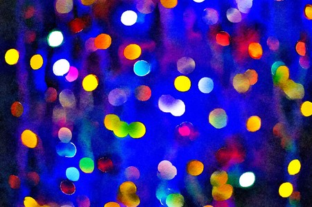 Watercolour painting of Christmas lights bokeh. Small vibrant multicloured lights with a dark blue background.
