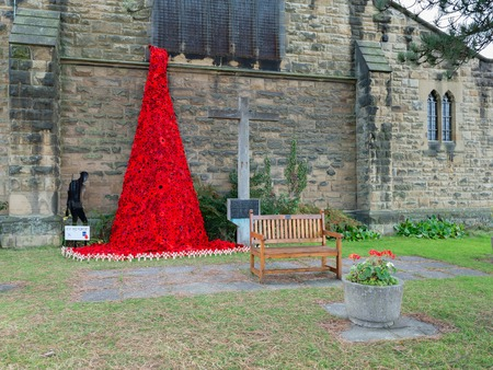 WREXHAM, UK - OCTOBER 31, 2018: Weeping Window poppy memorial, St Tydfils church, commemorating one hundred years since the end of the First World War. Knitted poppies made by local residents. Editorial
