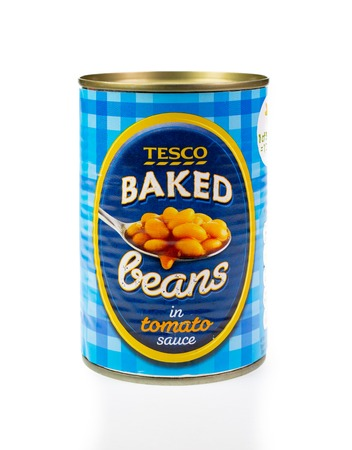 WREXHAM, UK - MARCH 31, 2017: Can of Tesco baked beans in tomato sauce, on a white background. Editorial