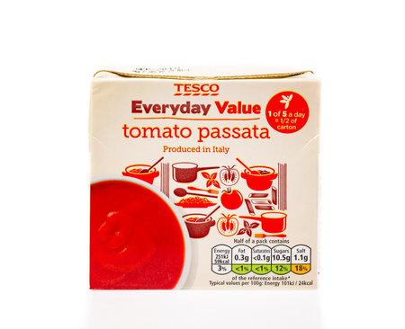WREXHAM, UK - MARCH 31, 2017: Tesco Everyday Value tomato passata in a carton, on a white background.