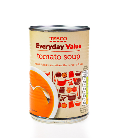 WREXHAM, UK - MARCH 31, 2017: Tesco Everyday Value tomato soup in a tin on a white background. Editorial