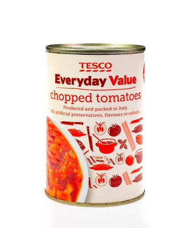 WREXHAM, UK - MARCH 31, 2017: Tesco Everyday Value chopped tomatoes in a can on a white background. Editorial