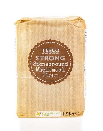 WREXHAM, UK - MARCH 31, 2017: 1.5kg bag of Tesco strong stoneground wholemeal flour for bread making. On a white background. Editorial
