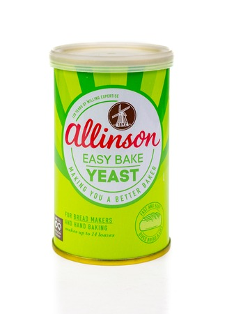 WREXHAM, UK - MARCH 31, 2017: Tub of Allinson easy bake yeast. A dried fast action yeast for use in bread makers and hand baking. On a white background.
