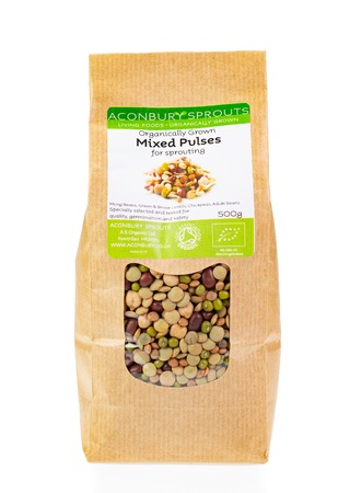 WREXHAM, UK - MARCH 31, 2017: 500g bag of Aconbury Sprouts organically grown mixed pulses for sprouting. On a white background.