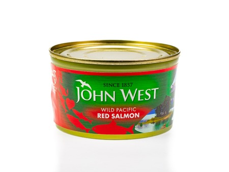 WREXHAM, UK - MARCH 31, 2017: Tin of John West wild Pacific red salmon, on a white background. Editorial