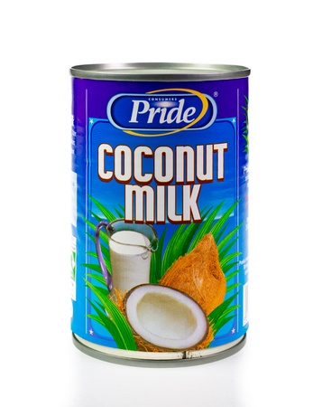 WREXHAM, UK - MARCH 31, 2017: Tin of Consumers Pride coconut milk, on a white background. Editorial
