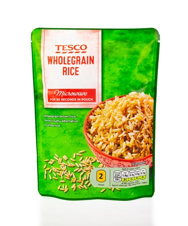WREXHAM, UK - MARCH 31, 2017: Microwave pouch of Tesco wholegrain rice, on a white background. Pre cooked rice ready to quickly heat and eat.