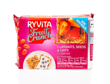 WREXHAM, UK - MARCH 31, 2017: Packet of Ryvita fruit crunch crispbreads with currants, seeds and oats, on a white background.
