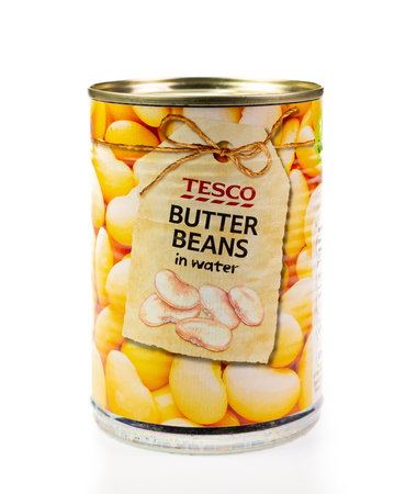 WREXHAM, UK - MARCH 31, 2017: Tin of Tesco butter beans in water, on a white background.
