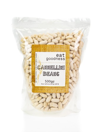 WREXHAM, UK - MARCH 31, 2017: 500g bag of Goodness Foods dried cannellini beans. On a white background.