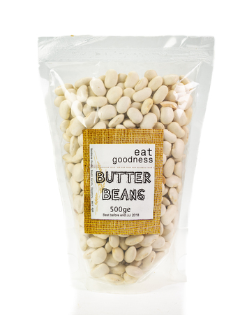 WREXHAM, UK - MARCH 31, 2017: 500g bag of Goodness Foods dried butter beans. On a white background.