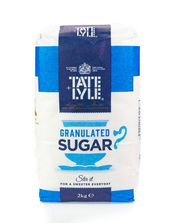 WREXHAM, UK - MARCH 31, 2017: 2kg bag of Tate and Lyle granulated sugar. On a white background. Editorial