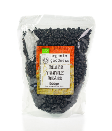 WREXHAM, UK - MARCH 31, 2017: 500g bag of organic Goodness Foods dried black turtle beans. On a white background.