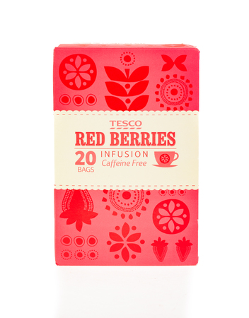 WREXHAM, UK - MARCH 31, 2017: Box of 20 Tesco red berries fruit tea bags. A naturally caffeine free infusion. On a white background.