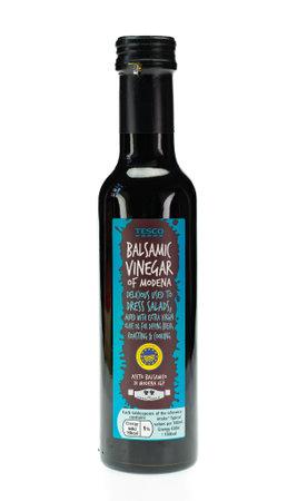 WREXHAM, UK - APRIL 01, 2017: Bottle of Tesco Balsamic vinegar of Modena. On a white background.