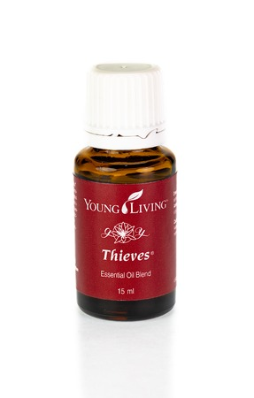 WREXHAM, UK - APRIL 01, 2017: 15ml bottle of Thieves essential oil by Young Living. Thieves is an antimicrobial blend containing clove, lemon, cinnamon, eucalyptus and rosemary oils. Editorial