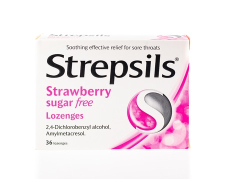 WREXHAM, UK - APRIL 01, 2017: Box of Strepsils on a white background. Strawberry flavour and sugar free. Used to relieve the symptoms of sore throats.