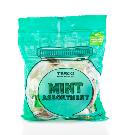 WREXHAM, UK - APRIL 01, 2017: Bag of Tesco mint assortment. Various individually wrapped sweets all with a mint flavour. No artificial flavours or colours. On a white background. Editorial