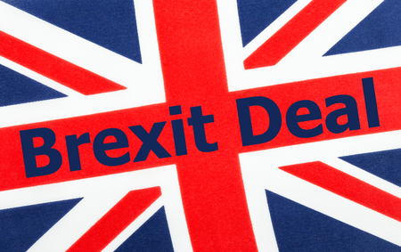 Brexit Deal written on a British Union jack flag. Photograph with added text.