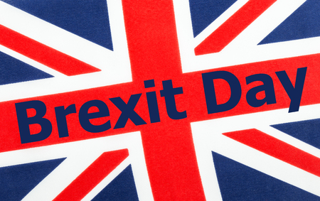 Brexit Day written on a British Union jack flag. Photograph with added text.