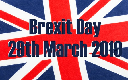 Brexit Day 29th March 2019 written on a British Union jack flag. Photograph with added text. Stock Photo