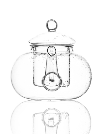 A single empty glass teapot isolated on a white background with reflection and condensation. High contrast black and white, black line lighting. Stock Photo