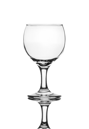 A single empty wine glass isolated on a white background with reflection. High contrast black and white, black line lighting. Stock Photo