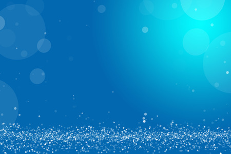 Bright blue bokeh background or overlay. Layer of glittering snow and backlit dust particles. Graphic resource with copy space. Stock Photo