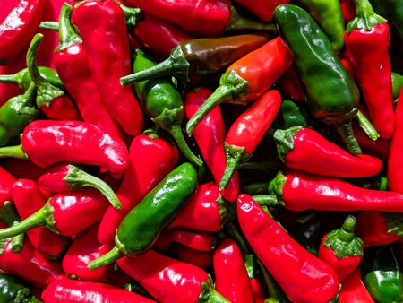 Red and green chilli peppers. Close up over head view of the freshly picked fruits. Stock Photo