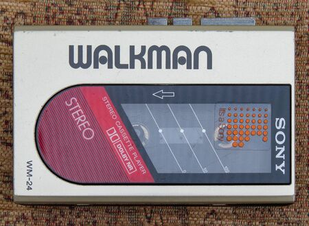 Wrexham, UK - April 12, 2019: Sony Walkman portable personal audio cassette player. Model WM-24. Genuine retro personal music system from the 1980s.
